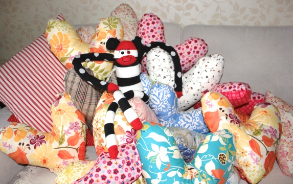 Sock Monkey Penelope helped us make over 60 heart pillows!